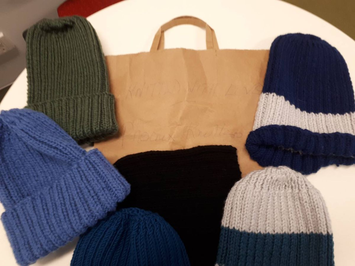 Donation of hand-made beanies from the Phoenix Knitters