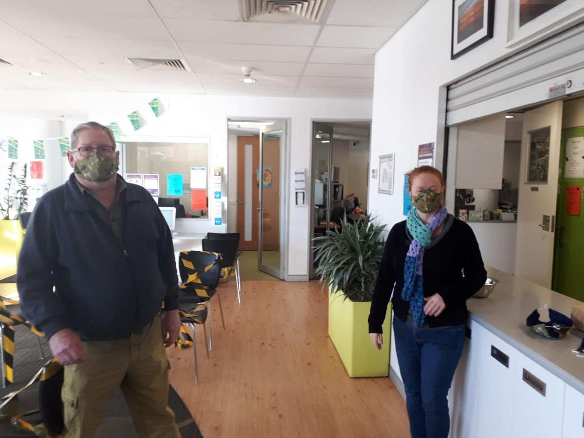 John and Cherie wearing hand-made face masks donated by the Tuggeranong Uniting Church