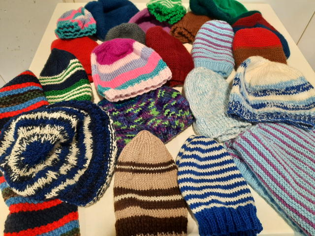 Donation of hand-made beanies from the knitters of the Tuggeranong Uniting Church