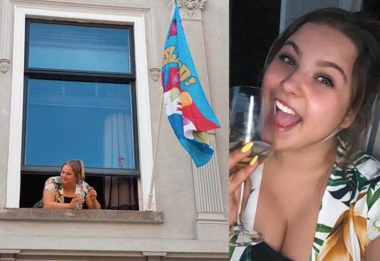 demi geslaagd, uit raam hangend met vlag, en met glas champagne