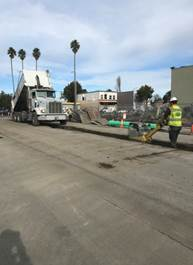 Forde laborer compacting backfill on 1st Street