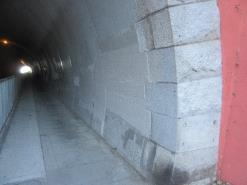 A picture containing building, outdoor, sidewalk, cement    Description automatically generated
