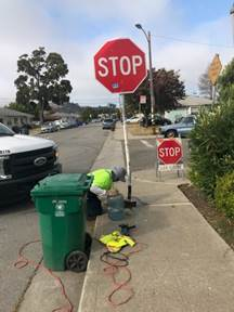 Stop sign repair at 209 Curry
