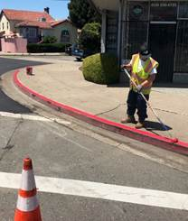Bissell and Broadway curb painting (2)