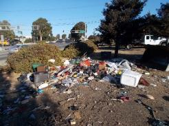 A pile of trash on the side of a road    Description automatically generated with medium confidence