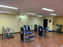 A gym with exercise equipment    Description automatically generated with medium confidence