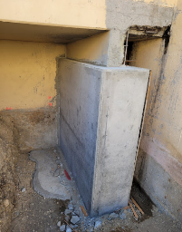 A picture containing building, ground, cement, dirty    Description automatically generated