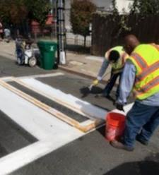 A group of people cleaning the street    Description automatically generated with low confidence
