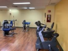 A room with exercise equipment    Description automatically generated with low confidence