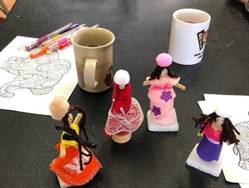 A group of small figurines    Description automatically generated with low confidence