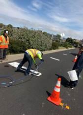 Approach lines to speed hump install with paint at Peninsula Dr