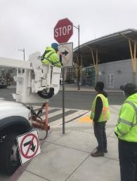 A construction worker holding a stop sign    Description automatically generated with low confidence