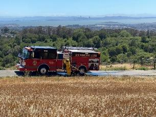 A red fire truck on the side of a road    Description automatically generated with low confidence