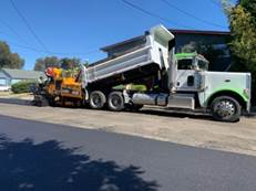 Paving operations on Carlos Ave