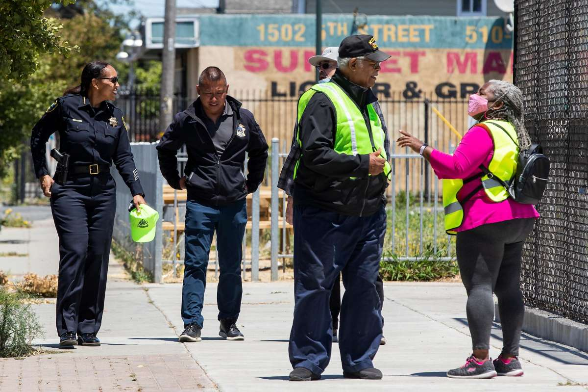 Richmond Police Chief Bisa French meets with local constituents and officials after a Walking School Bus event to promote safe streets for students traveling between Verde Elementary School and programs at Shields-Reid Community Center in Richmond, Calif. Monday, June 14, 2021. Richmond Police Chief Bisa French and her allies recently defeated a plan by Richmond's Reimagining task force to shift $10.3 million from the police budget to social services, which would have required laying off 35 officers.