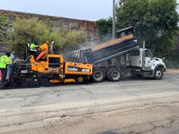 Paving operations on Clinton Ave