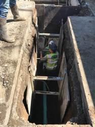 Forde installing manhole base on 24th St.