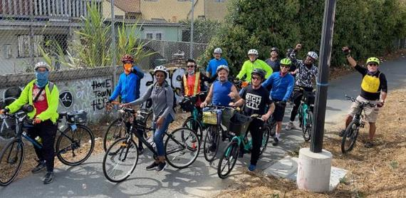 A group of people on bicycles    Description automatically generated with medium confidence