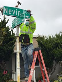 Nevin and 38th st street name install and stop sign replace