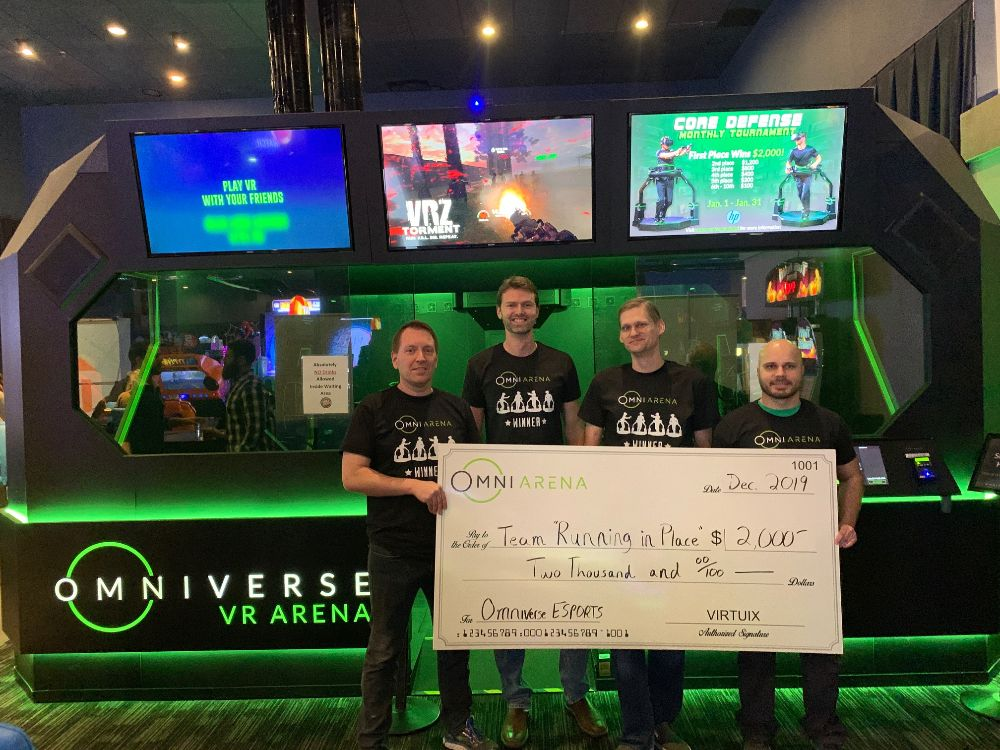 Omni Arena winners with check