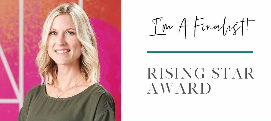 "Image shows a headshot of Kelly on the left (she is smiling wearing an olive green blouse. There is a bright pink and orange backdrop) and text on the right, ""I'm a finalist! Rising Star Award."""