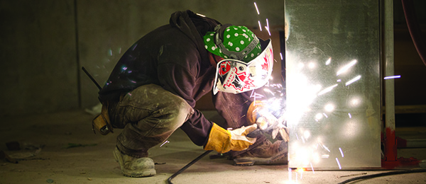 Photo of construction boilermaker doing welding.