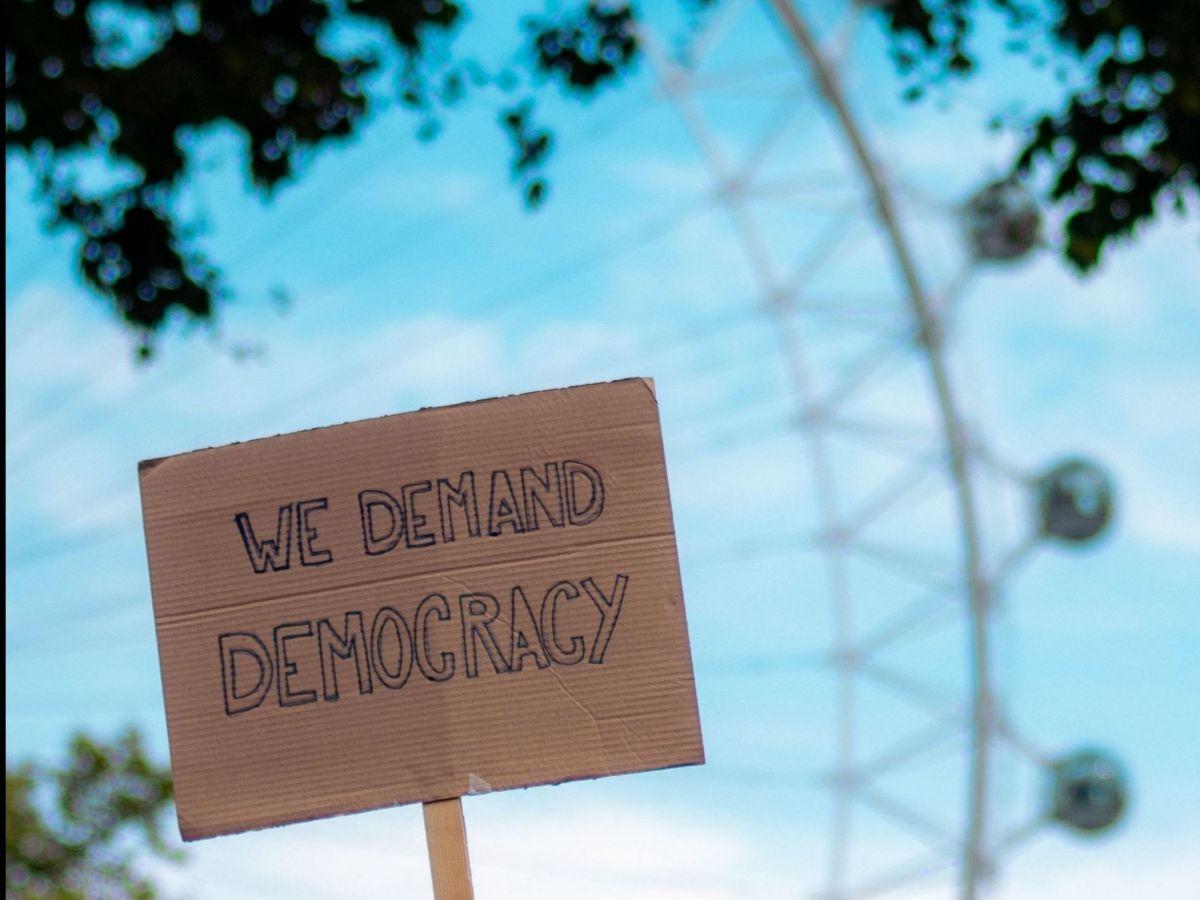 We demand democracy banner