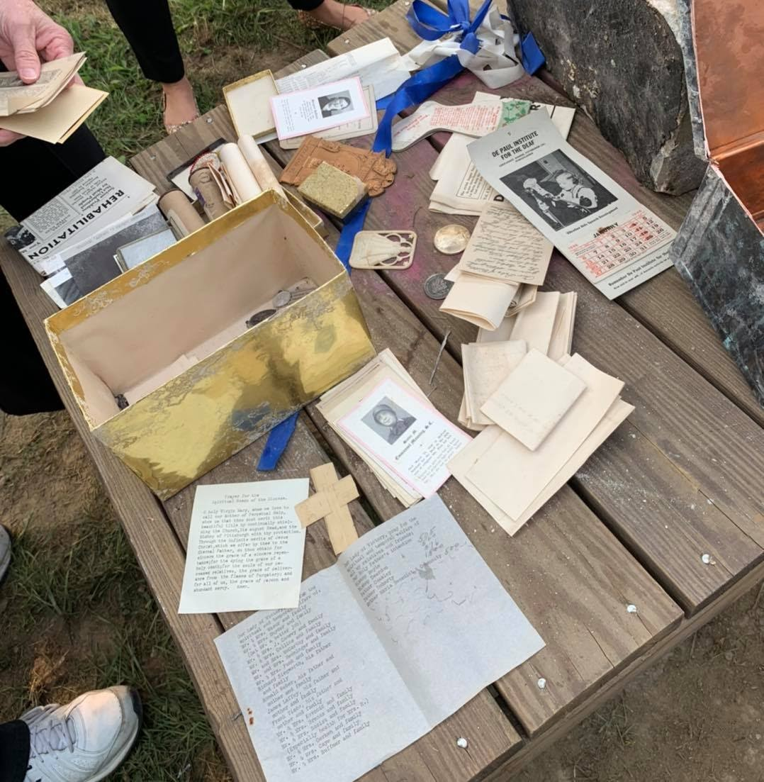 A selection of items removed from the time capsule. Photo Source: DePaul School for Hearing and Speech