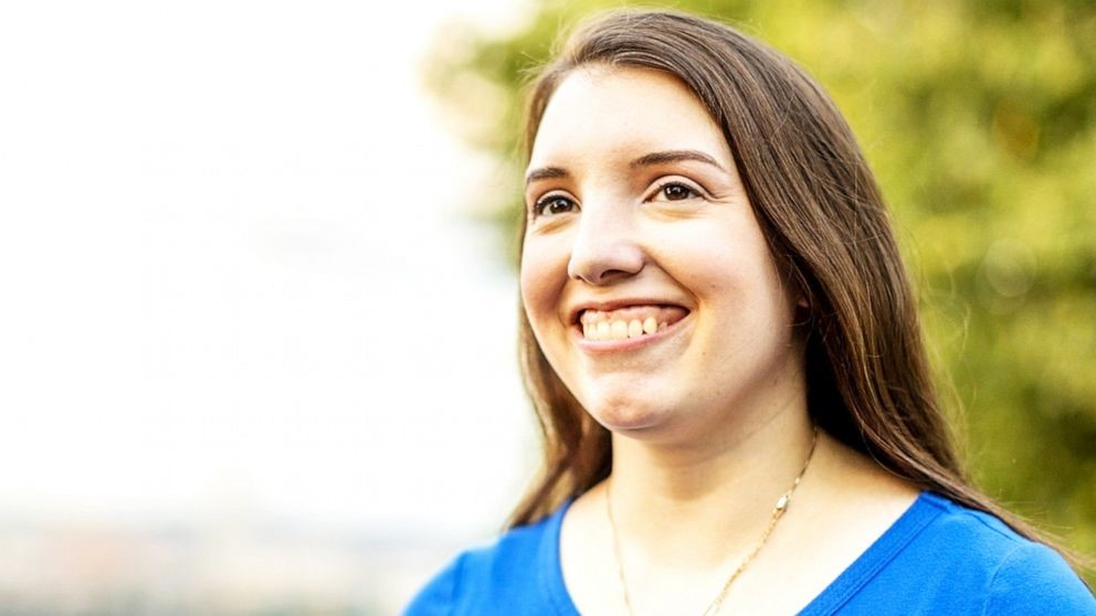 Photo of Jessica Benham. She has long brown hair and a big smile.