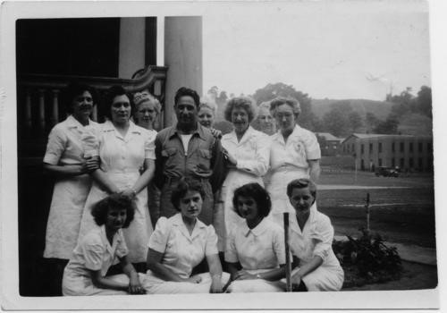 """Members of the Mayview Hospital Occupational Therapy Department, with Patricia """"Pat"""" Clapp standing second from left. She began working in the department after graduating from Wilkinsburg High School in 1947, and it informed her thinking on institutionalization. Citation: Patricia Clapp Papers and Photographs, MSS 1196, Detre Library and Archives, Heinz History Center."""