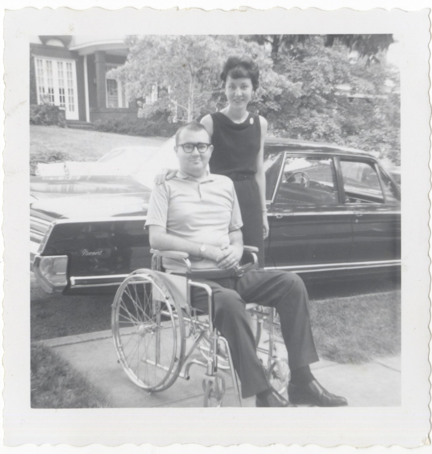 Black and white photograph of accessibility advocates Holly and Paul Dick in front of their Chrysler Newport, which was adapted for Paul's use in 1966. (From the Holly and Paul Dick Family Papers and Photographs, MSS 1177, Detre Library & Archives at the Heinz History Center.