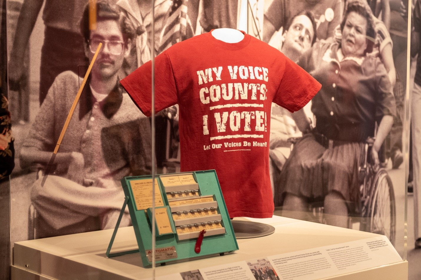 Photos, a t shirt, and other antique looking exhibit items