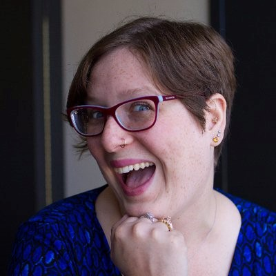Head shot of Dr. Rachel Whitman. She has short brown hair, glasses, and a big smile.