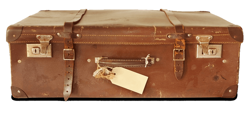 The image of a worn, brown leather suitcase, lying on its side with buckled straps and brass locking clasps facing the viewer. The handle is wrapped with twine attaching a blank paper tag.