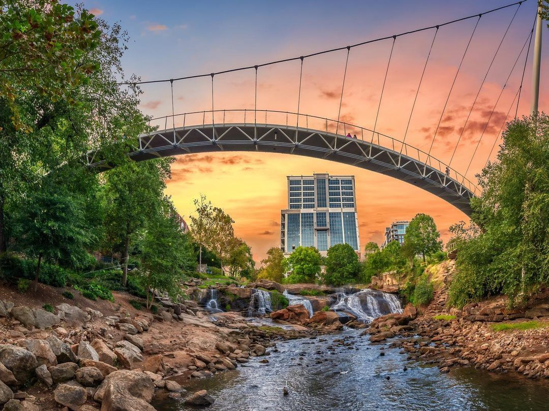 Photo of the Liberty Bridge at Falls Park in downtown Greenville by @vanzeppelinaerial
