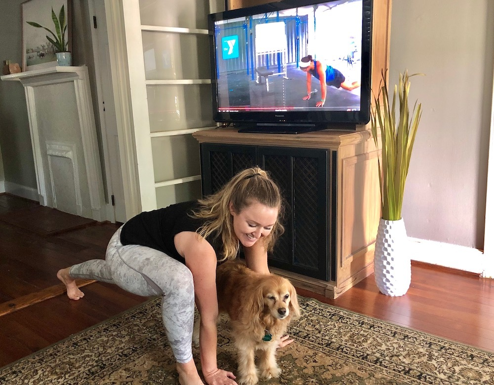 Chloe stretching with coach Rebecca and dog Scout during my virtual demo of a Beast Mode class offered at the YMCA of Greenville