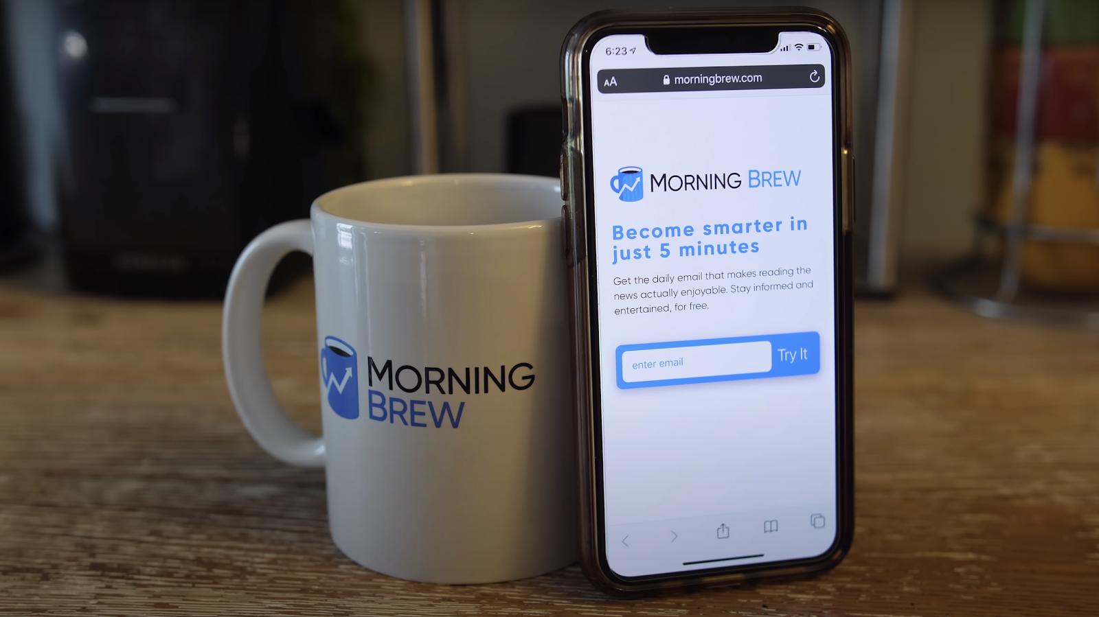 Coffee mug and phone