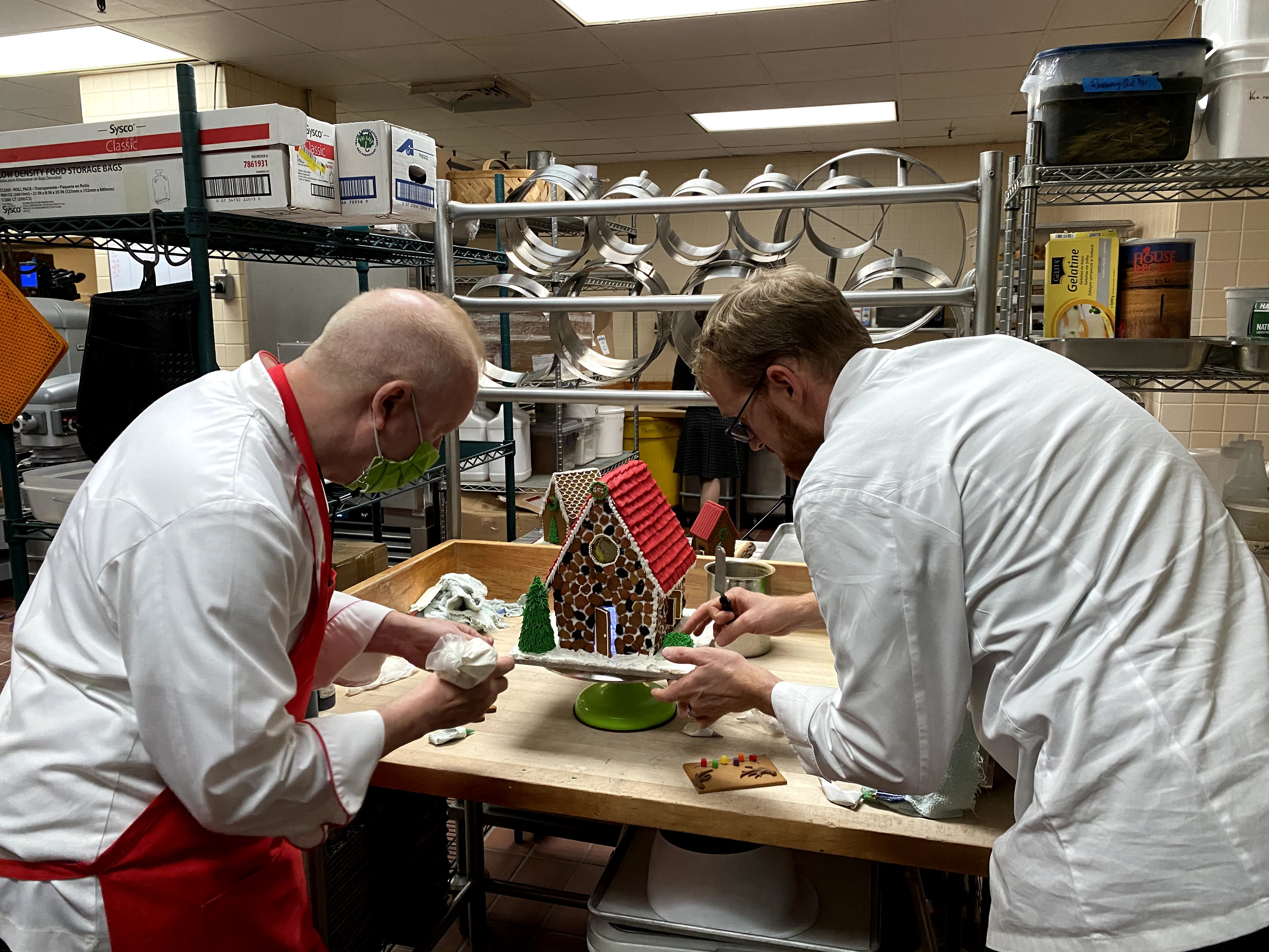 Chefs making a gingerbread house during Baking Spirits Bright with The Omni Grove Park Inn | Photo provided