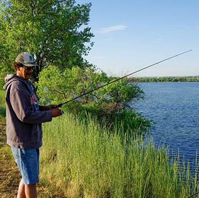 A man fishes at Cherry Creek State Park