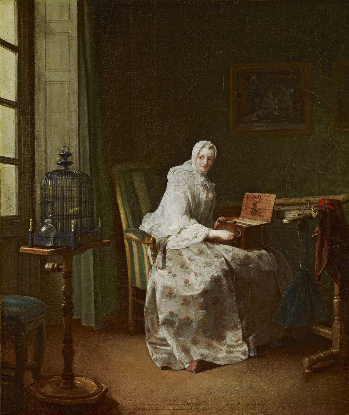 Oil painting of a seated woman in a white dress and bonnet playing a bird-organ in a room with caged bird