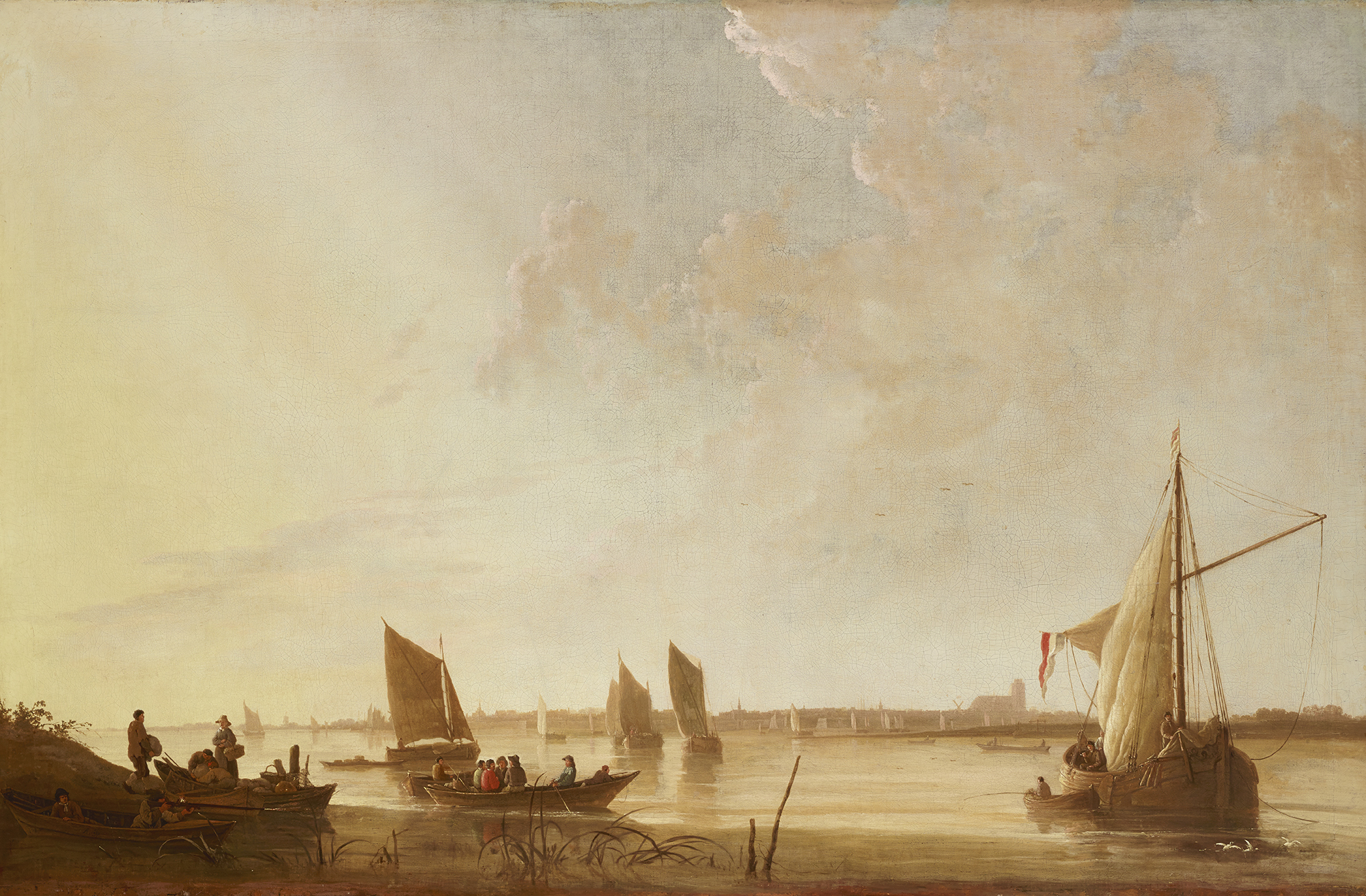 "Aelbert Cuyp's ""Dordrecht: Sunrise."" Sailboats and rowboats float in the river Merwede in a golden morning haze"