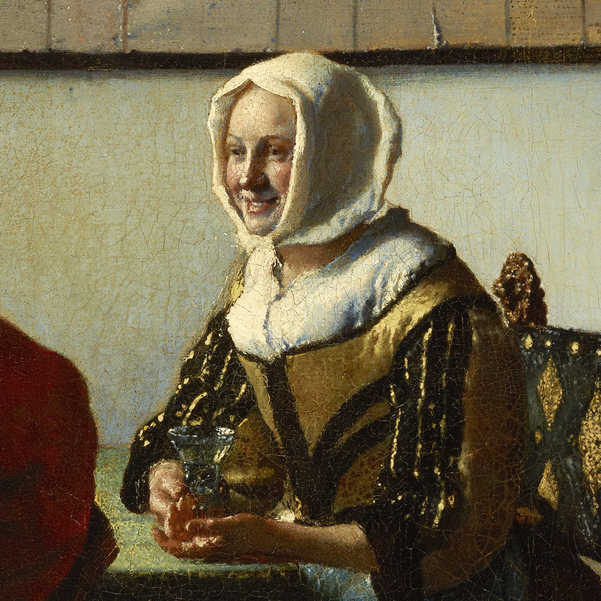 Oil painting of a laughing woman sitting at a table