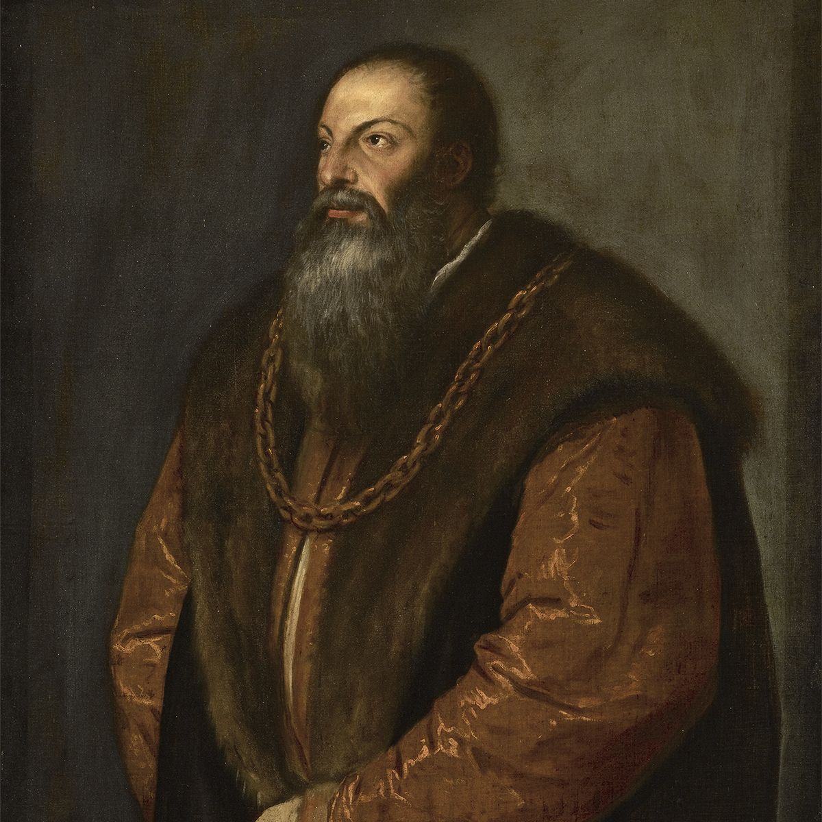 A detail of Titian's oil painting of Renaissance writer, Pietro Aretino: the bearded man wears a sleeveless black cloak with a fur collar over a copper-gold robe and a gold chain