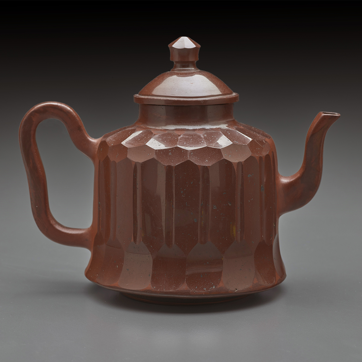 Red stoneware teapot with cover