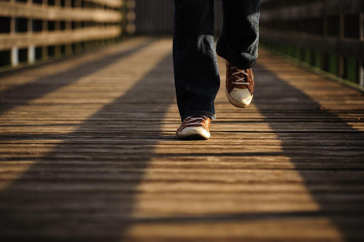 person walking on pier