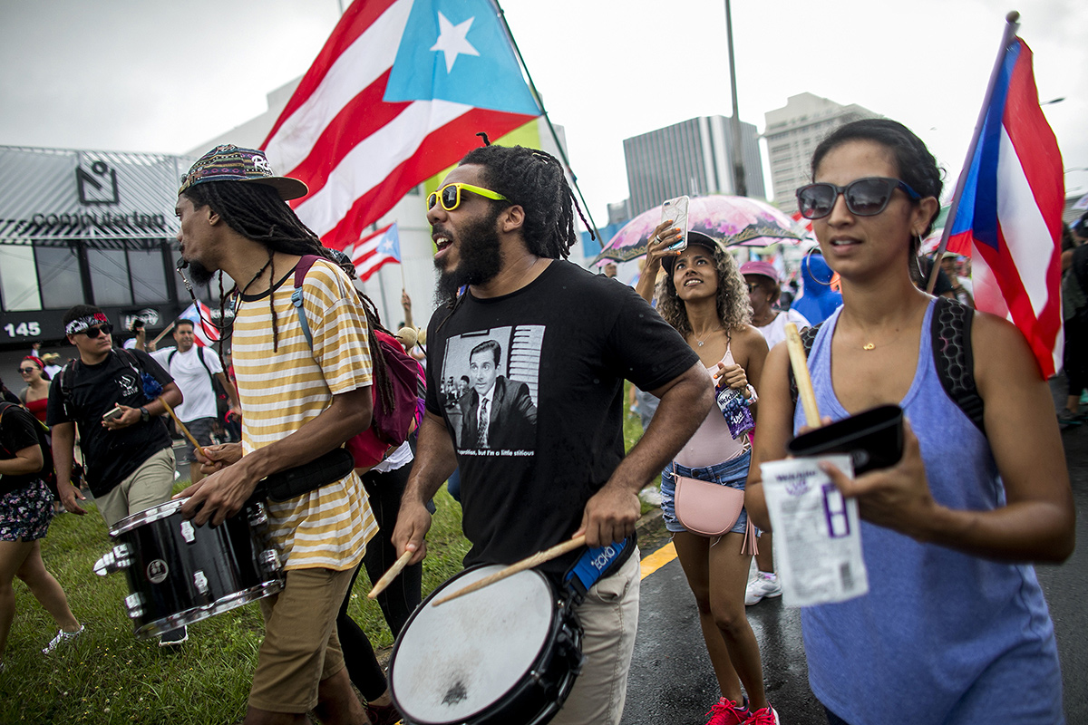 People marching with drums and flags