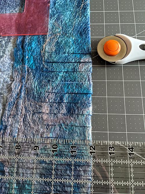 Cutting Tassels on the 'Scarf.'