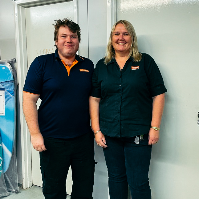 Josh and his employer stand in their uniforms