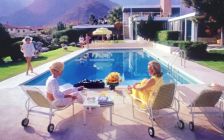 women by the pool image