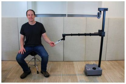 Georgia Tech robotics expert Charlie Kemp poses with his robot Stretch RE1 from Hello Robot, Inc. Robots like Stretch REI will be used in the TRI research to improve how people and robots work together. (Photo credit: Charlie Kemp, Georgia Tech)